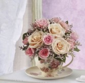Victorian Teacup Pink spray roses in a teacup