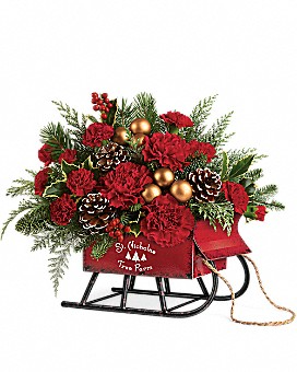 Vintage Christmas Sleigh centerpiece in Claremont, NH | FLORAL DESIGNS BY LINDA PERRON