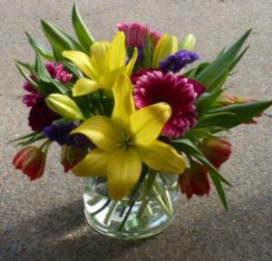Invigorating Colors in Glass Cylinder Lilies, Tulips, Gerbera Daisies in Mechanicsburg, PA   Garden Bouquet