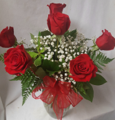 6 Red Roses arranged in a vase with baby's breath and bow!