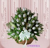 Vogue's White Roses Basket Arrangement Basket Arrangement