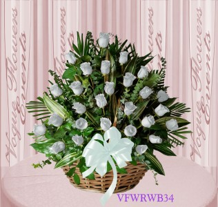 Vogue's White Roses Basket Arrangement Basket Arrangement