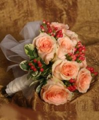Coral Roses & Red Hypericum Bridal Wedding Bouquet in Ozone Park, NY | Heavenly Florist