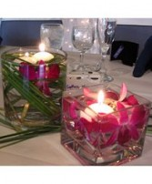 Romantic Orchids & Floating Votives Wedding Reception Arrangements