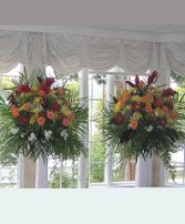 Flowers Displayed on Columns Reception Arrangements