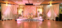 Flower wall with Golden Indian frames with Luxury Chairs