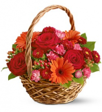 Basket Of Warmth In Reds, Orange And Fuschia Basket Arrangement