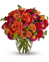 Warm Oranges, Reds, And Fuschia Flower Arrangement