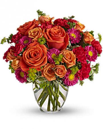Warm Oranges, Reds, And Fuschia Flower Arrangement