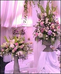 Floral Arrangements on Pedestals Display Wedding Reception Flowers in Milwaukie, OR | Poppies and Paisley Events