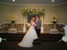 FLORAL COVERED ARBOR FORMAL CHURCH WEDDING