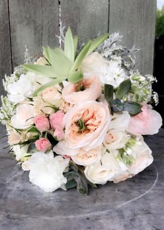 Wedding bouquet Garden roses, succulents and lisianthus