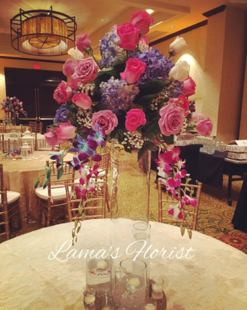 Wedding centerpiece with roses and orchids