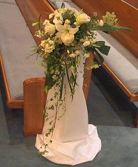 Wedding Ceremony Flowers Cascading Pew Marker  in Fort Lauderdale, FL | ENCHANTMENT FLORIST
