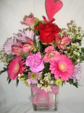 Pink Delight!! Mixture of Gerbera Daisies, rose,  carnations, lilys, daisies, and filler all in clear vase with a heart pic!
