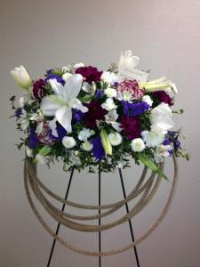 Western Rope Easel Funeral Arrangement in Burns, OR | 4B Nursery And Floral