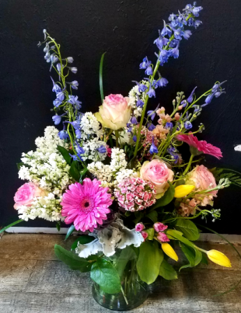 WHILE SUPPLIES LAST  Spring Spender Lilacs, Roses, Tulips with spring accent flowers