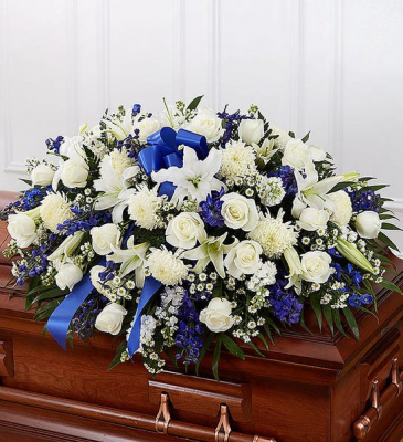 white and blue casket spray  funeral flowers