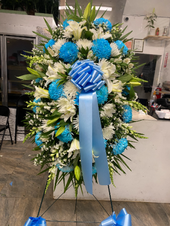 White and blue flowers with lilies We are so sorry for your loss