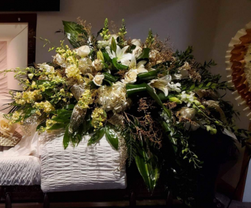 WHITE AND GOLD REST CASKET FLOWERS