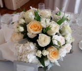 D'arcy White and peach table arrangement