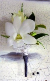 White as snow orchid boutonniere