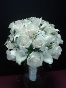 White bridal bouquet White roses and Stephanotis