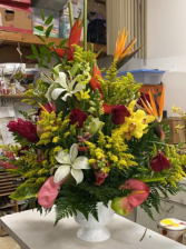 White urn with mixed tropical flowers