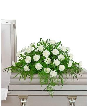 White Divinity Casket Spray Sympathy in Nevada, IA | Flower Bed