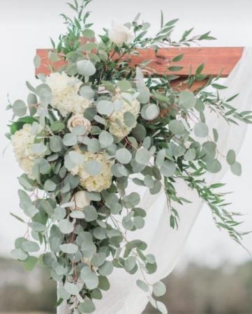 White & Eucalyptus Arch Ceremony Flowers