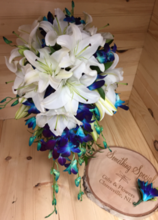 White lilies and dendrobium orchids Wedding bouquet in Clarenville ...