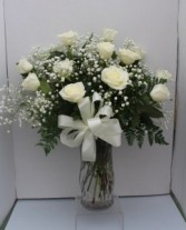 White Long Stem Roses Arranged in Glass Vase