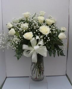 White Long Stem Roses Arranged in Glass Vase