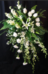 white orchids standing funeral spray