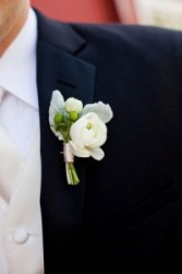 White Ranunculus Boutonniere  with greens and ribbon tie