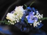 White rose and delphinium corsage