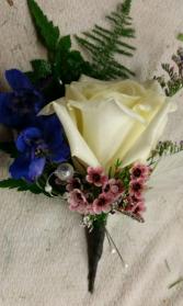 White rose, Blue delphinum & waxflower Boutonniere