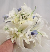 WHITE ROSES, STEPHANOTIS, LILIES, SOFT BLUE DELPHI WEDDING BOUQUET