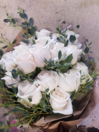 White roses wrapped