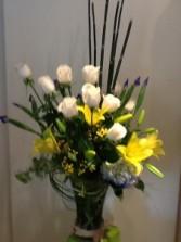 white roses yellow lilies vase