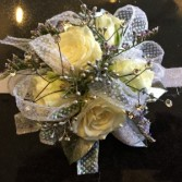White spray roses with white sparkle ribbon and rhinestone accents