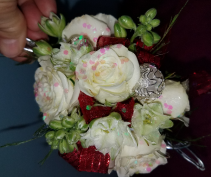 White spray with red ribbon corsage