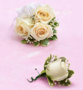 White sweetheart rose corsage with  matching bout!