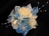 White Sweetheart Roses/Light Blue/Silver Accents  Corsage