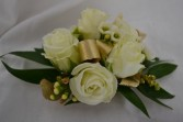 white with gold wrist corsage