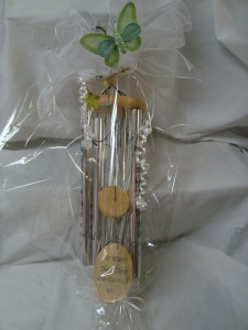 Wind Chimes with bow and butterfly decor. Footprints...saying is on chimes and wood.