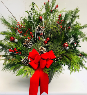 Winter Pot with Red Bow  in Fitchburg, MA | CAULEY'S FLORIST & GARDEN CENTER