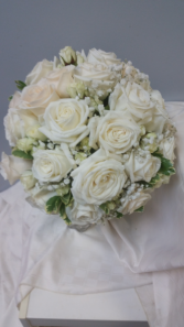 Winter wedding bouquet White roses and babies breath.
