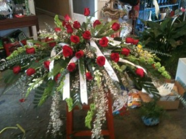 With Blessed Memories  Red Rose Casket Spray