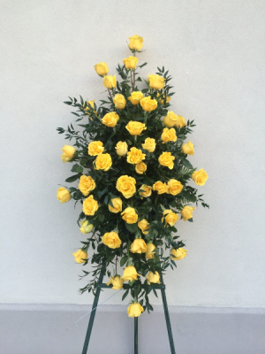 With Deepest Sympathy Yellow Rose Standing Spray in Corpus Christi, TX | Golden Petal Florist